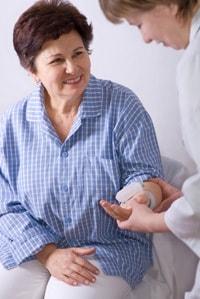 Woman having her blood pressure taken.