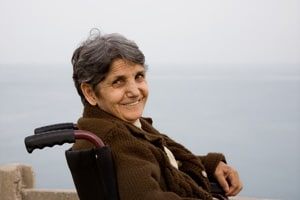 Smiling elderly woman in a wheelchair.